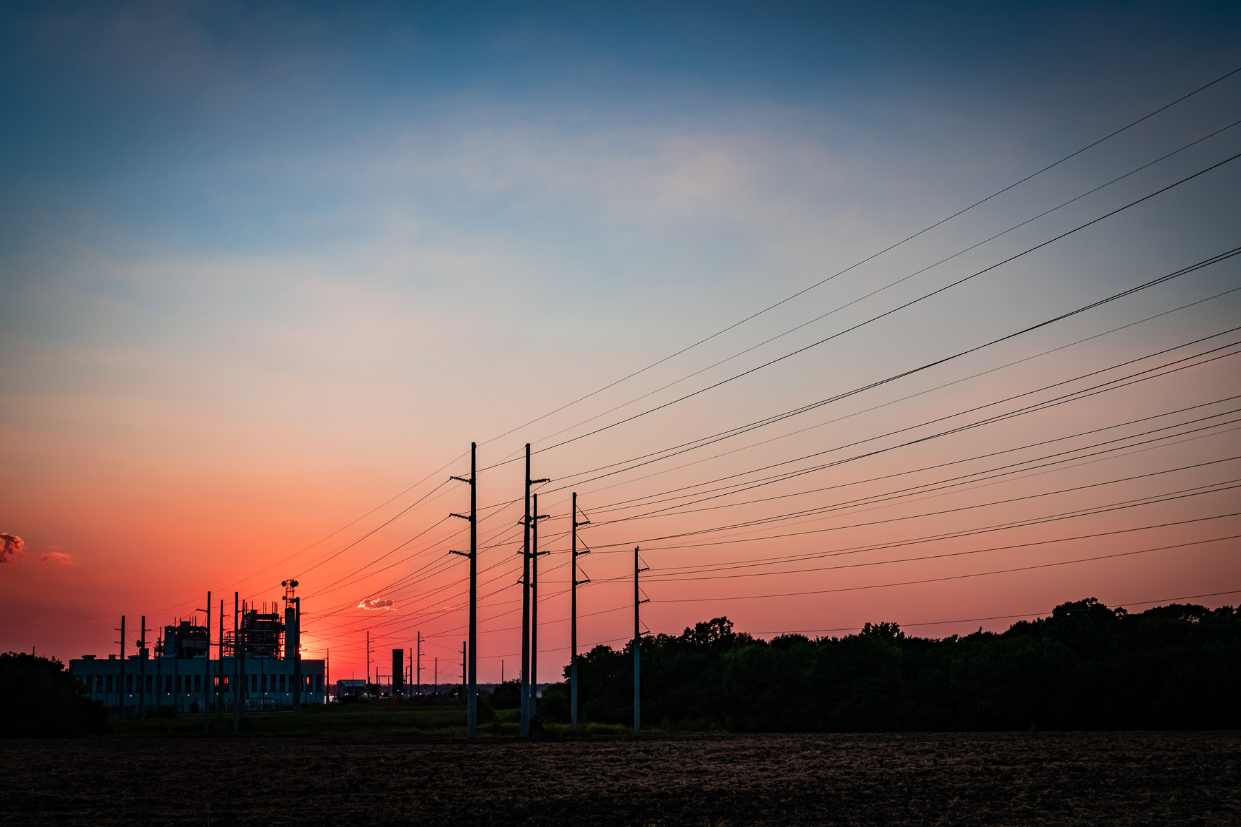 The sun sets behind the Garland City Power Plant at Lake Lavon, Texas.
