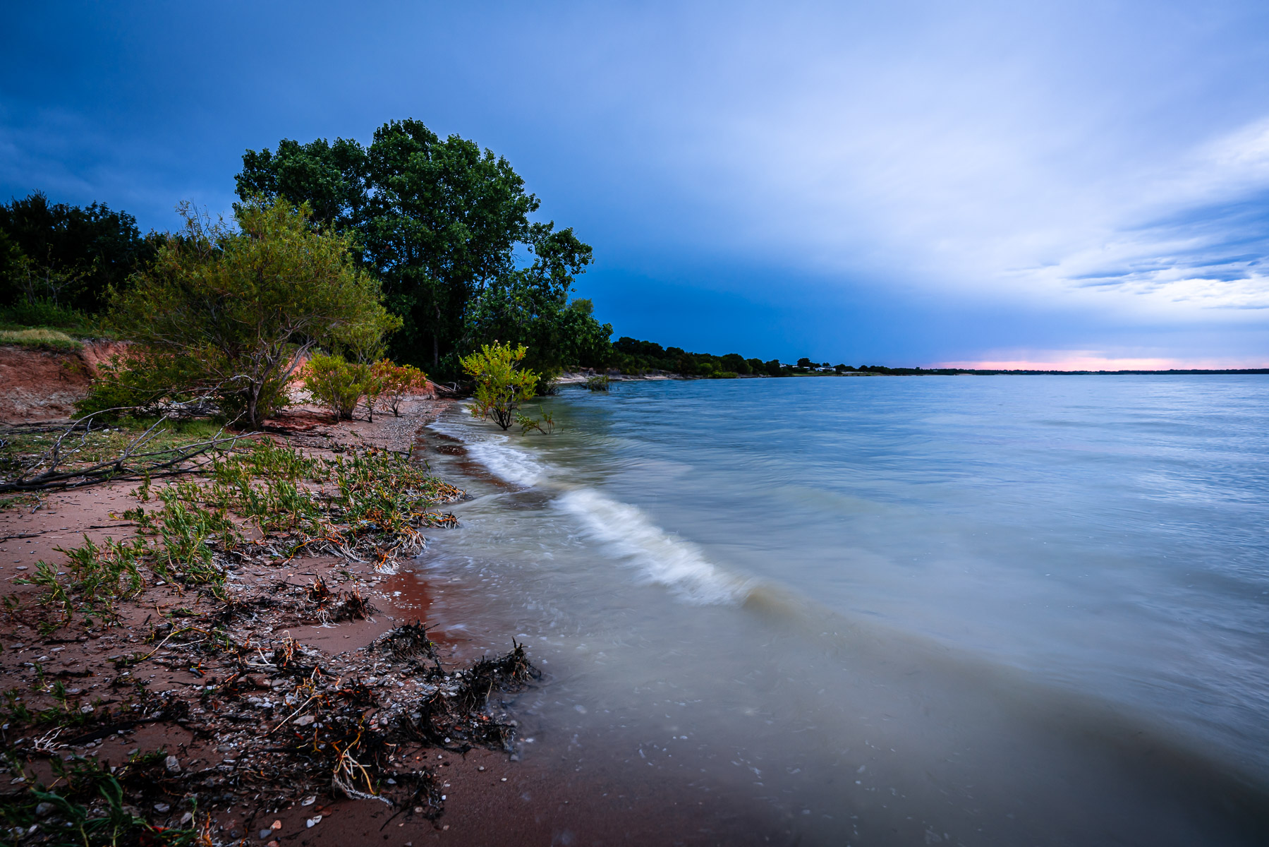 Waves roll onto shore at North Texas' Lake Lavon.