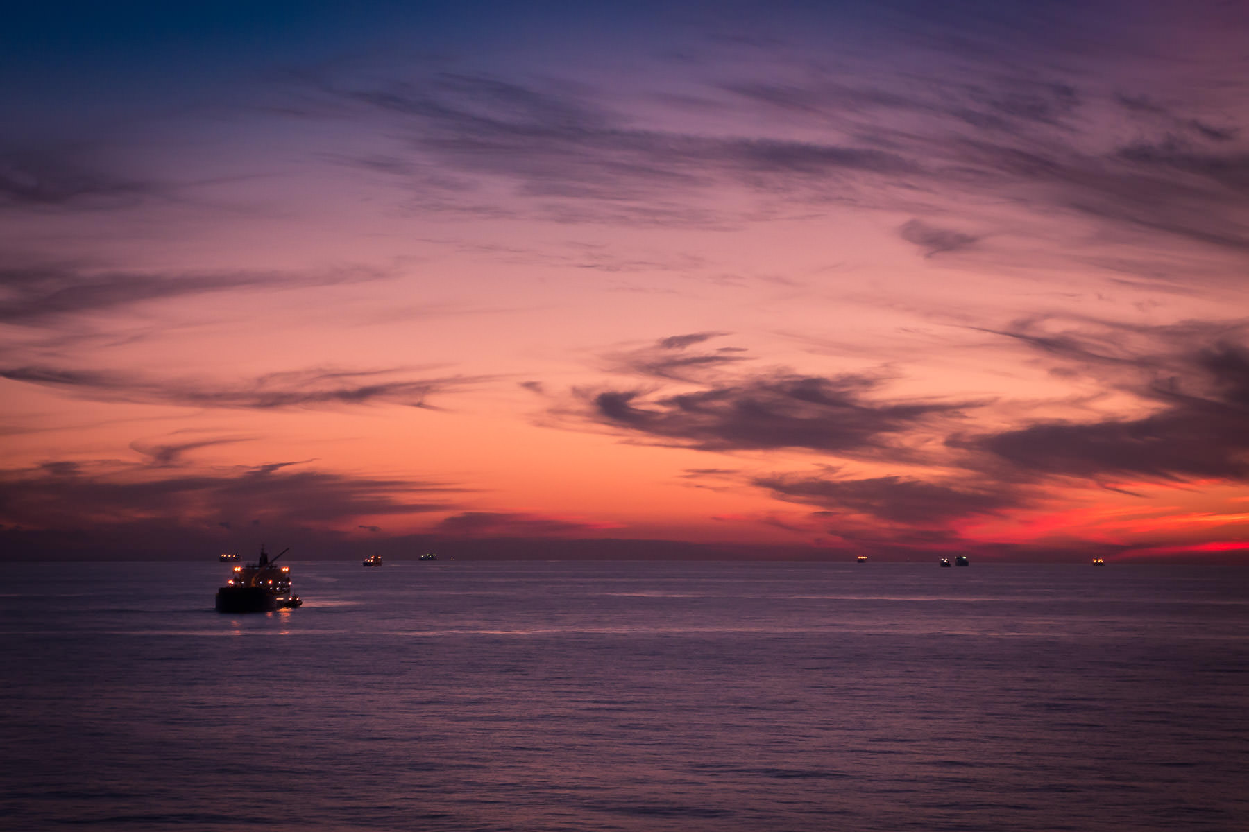 Ships await entry into the Port of Houston at the Bolivar Roads Anchorage off the coast of Galveston, Texas.
