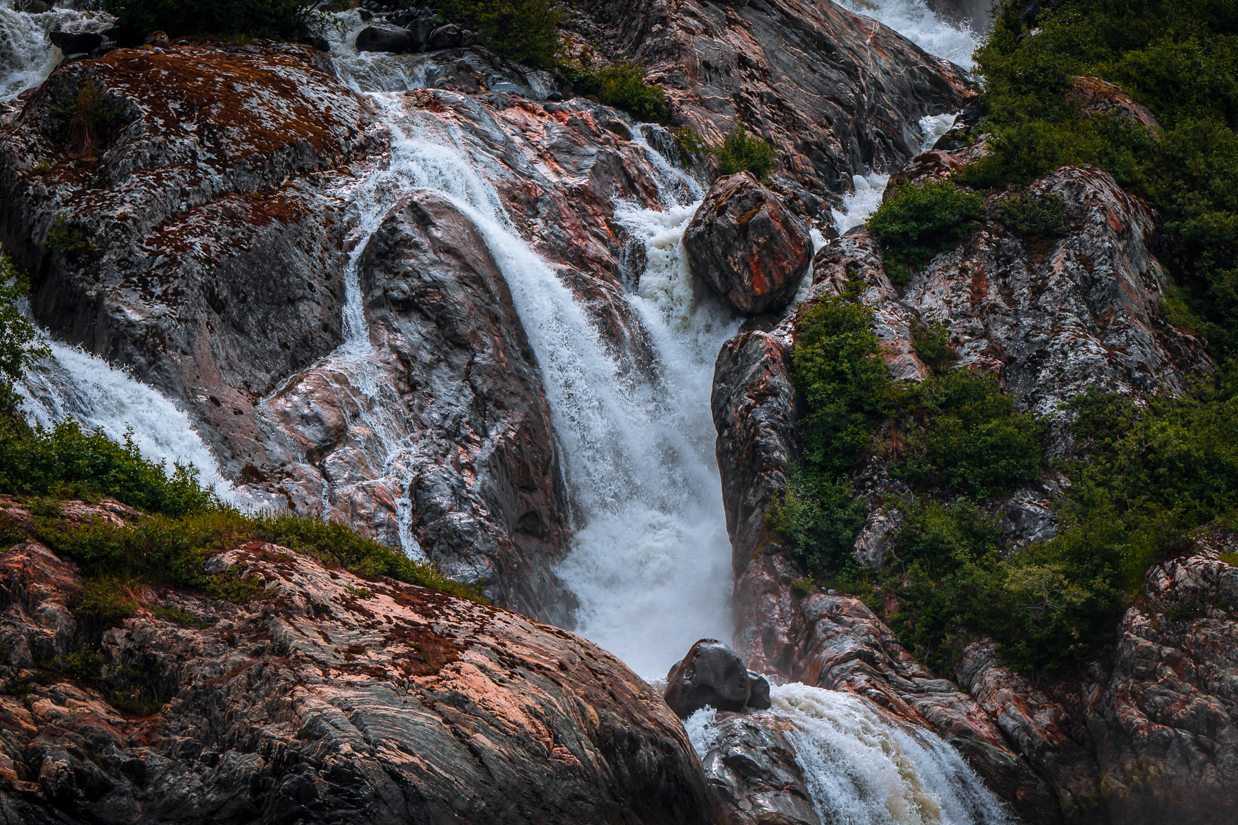 Water pours over rocks along Alaska's Stephens Passage near Juneau.