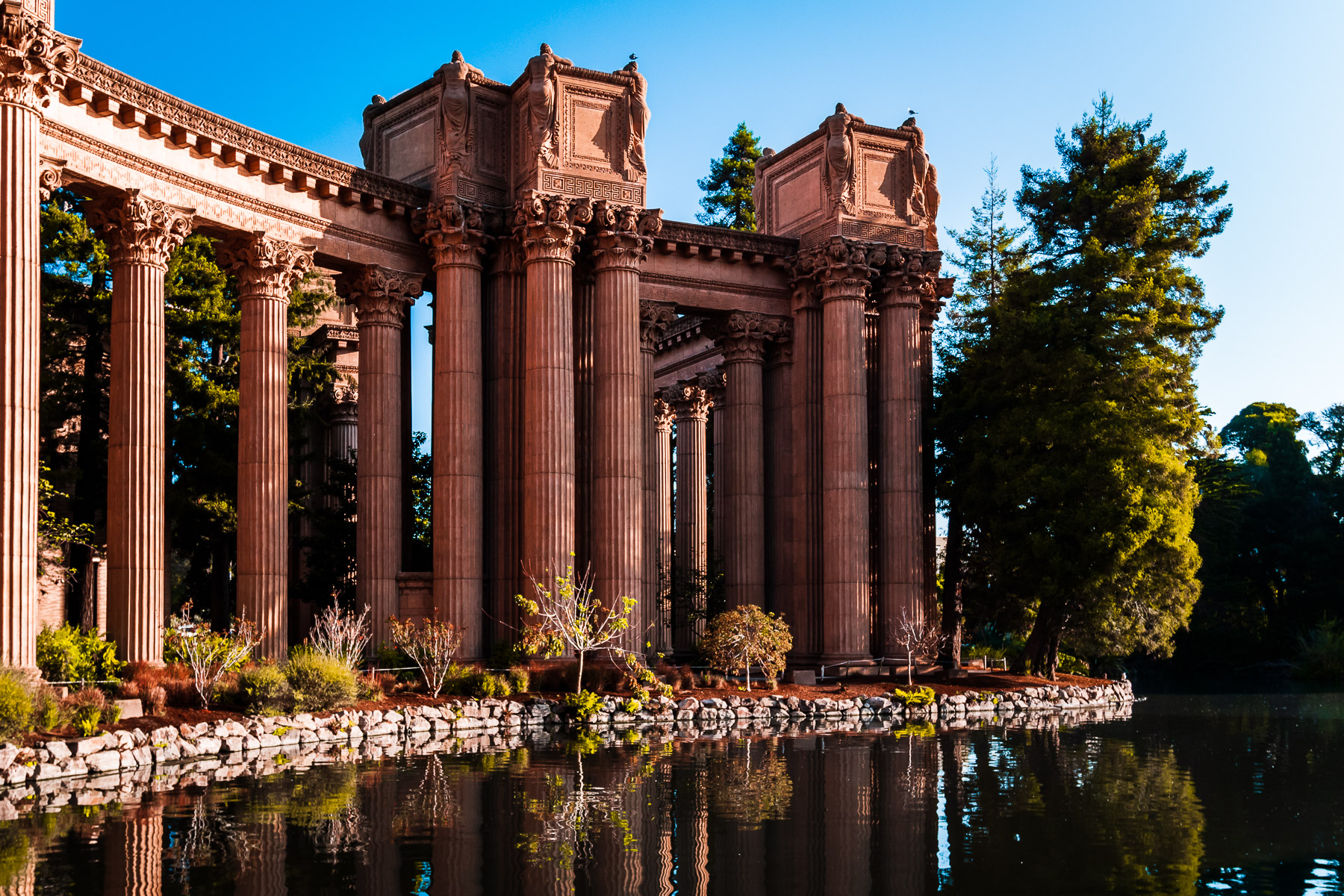 The morning sun lights the ornate columns of San Francisco's Palace of Fine Arts.