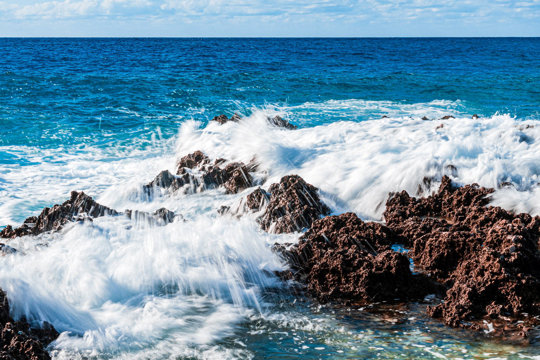 Waves splash over rocks at Turtle Reef, Grand Cayman.