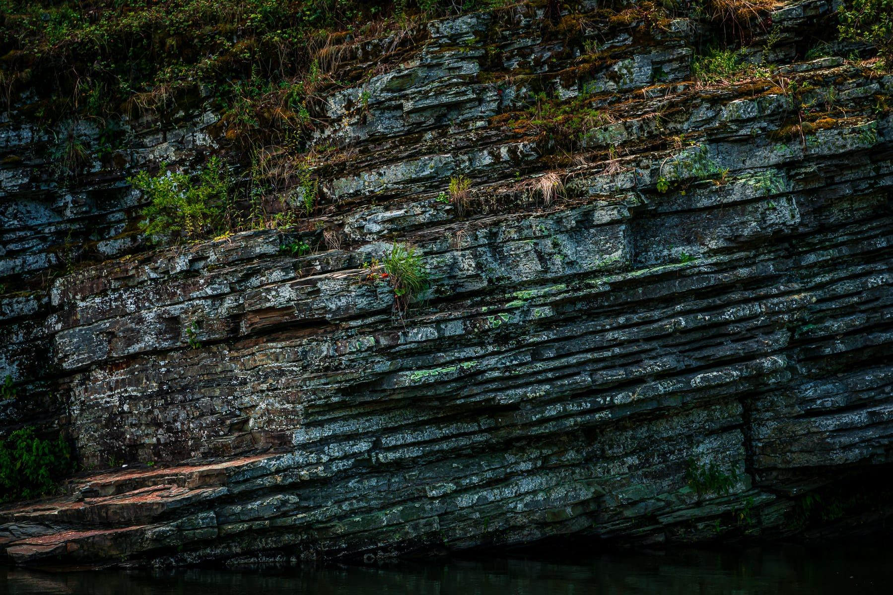 Layers of rock spotted along the Mountain Fork River, Beavers Bend State Park, Oklahoma.