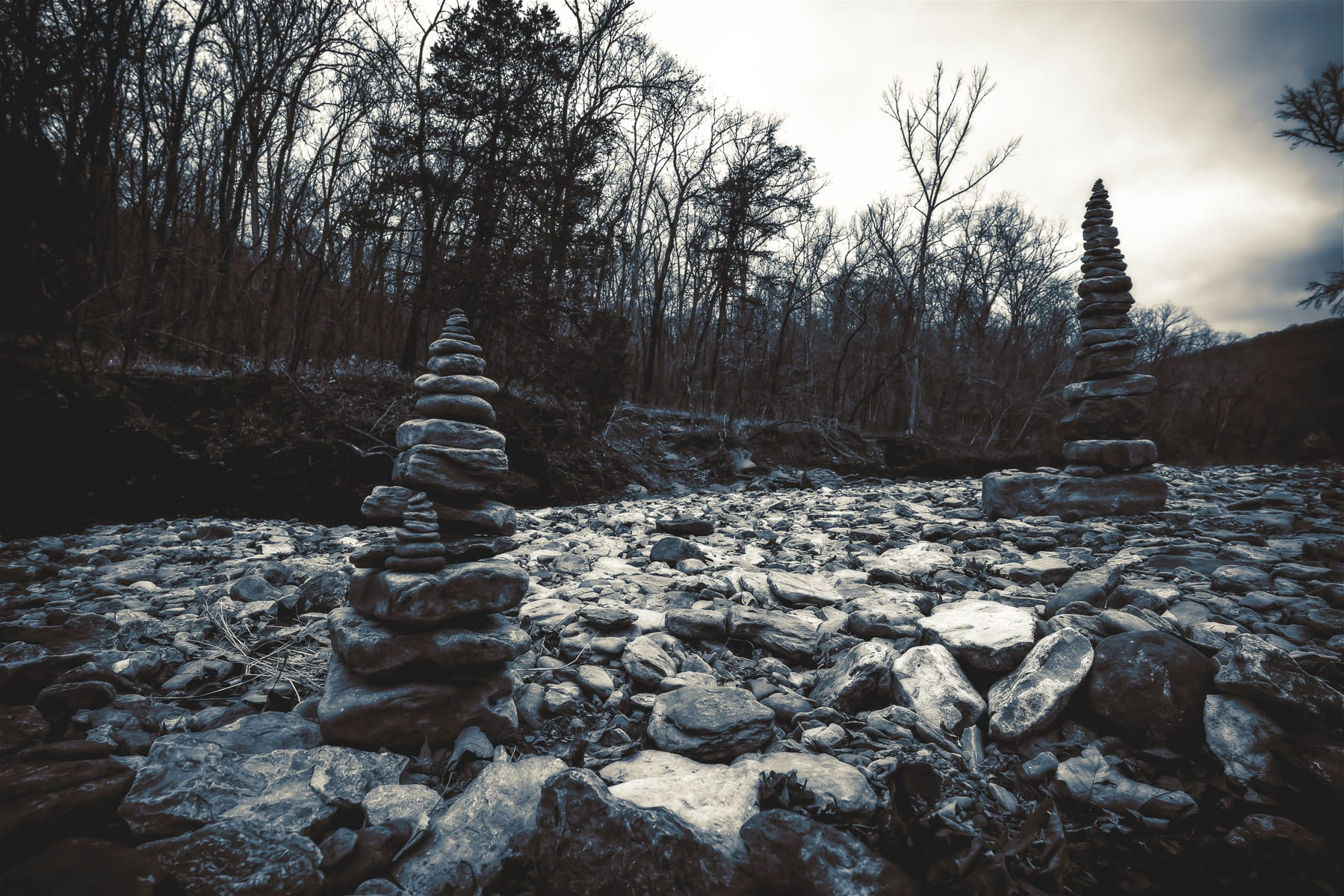 Stacked rocks spotted in a dry riverbed at Devil's Den State Park, Arkansas.