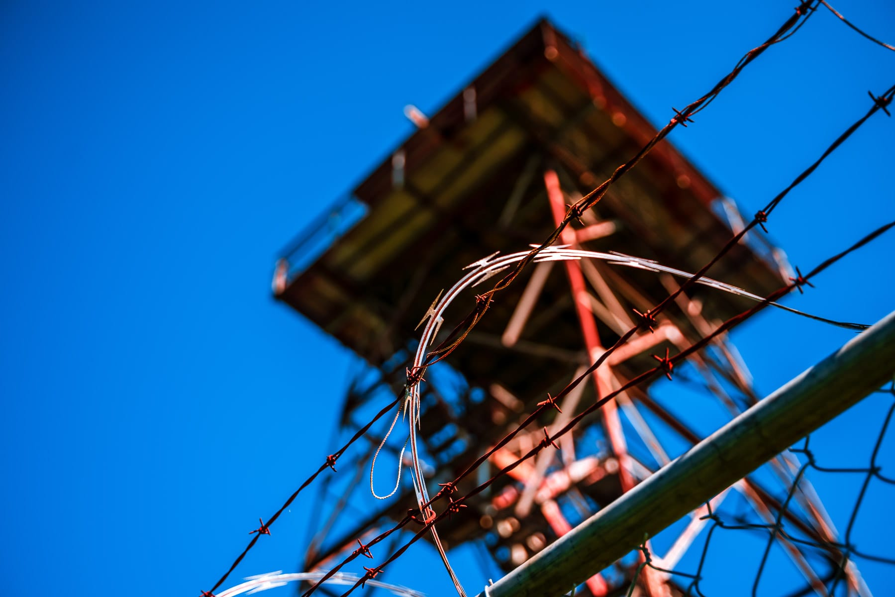Barbed wire keeps out trespassers at an abandoned fire lookout tower at Rich Mountain, Arkansas.
