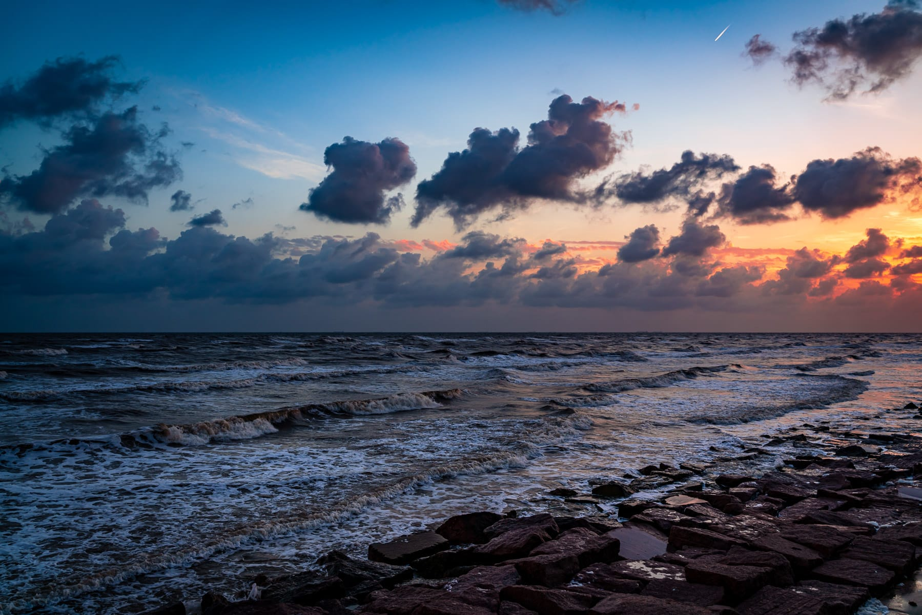 The sun rises on the Gulf of Mexico at Galveston, Texas.