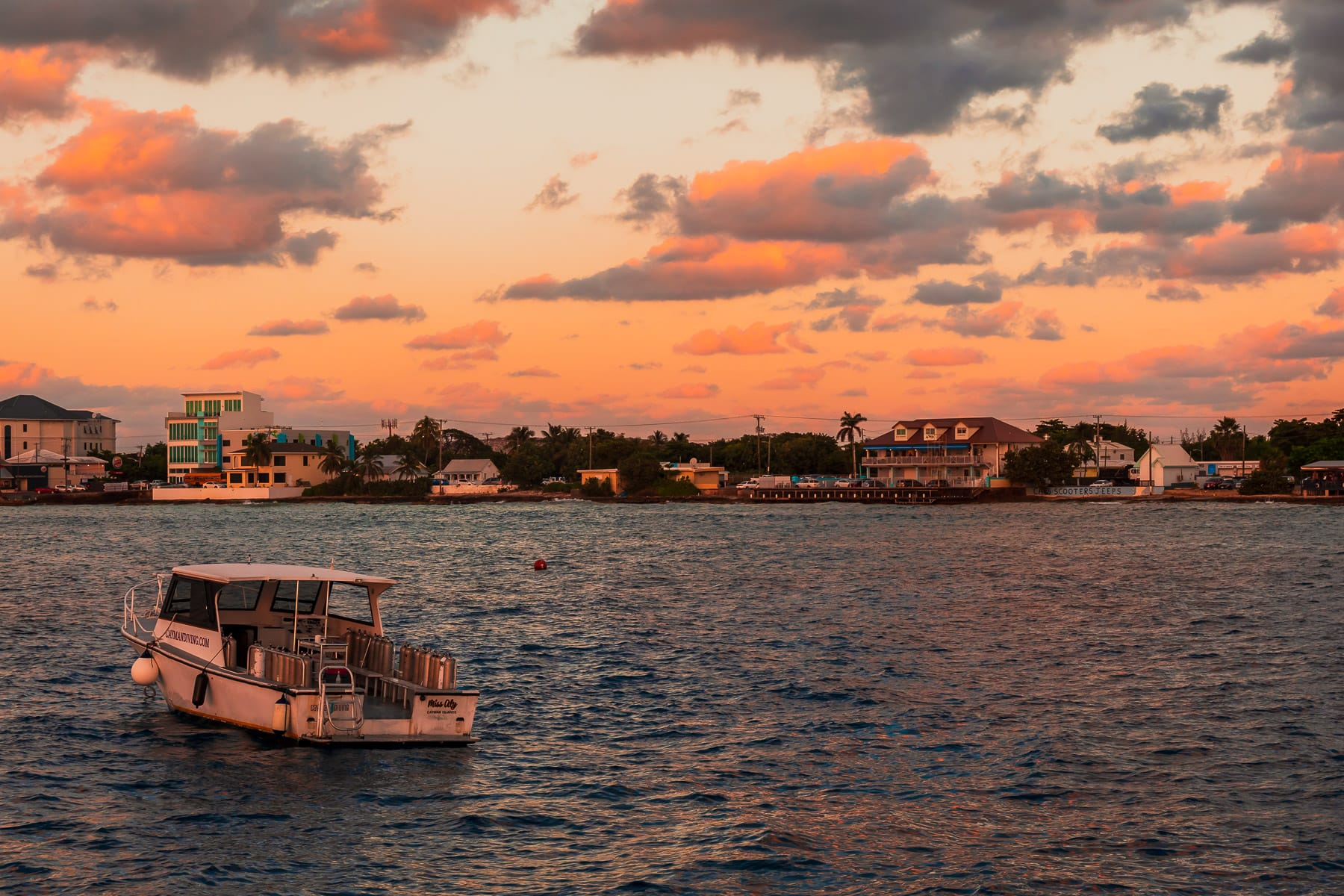 The sun sets on a dive boat off the coast of George Town, Grand Cayman.
