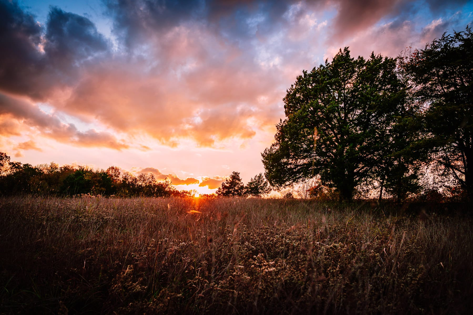 The sun sets on McKinney, Texas' Erwin Park.