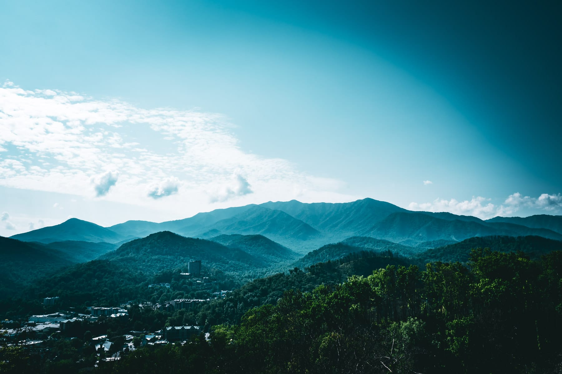 Gatlinburg, Tennessee, nestled in the hazy Great Smoky Mountains.