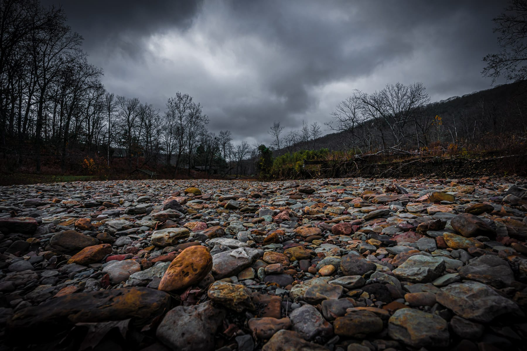 The colorful rocks of a dry riverbed at Devil's Den State Park, Arkansas.