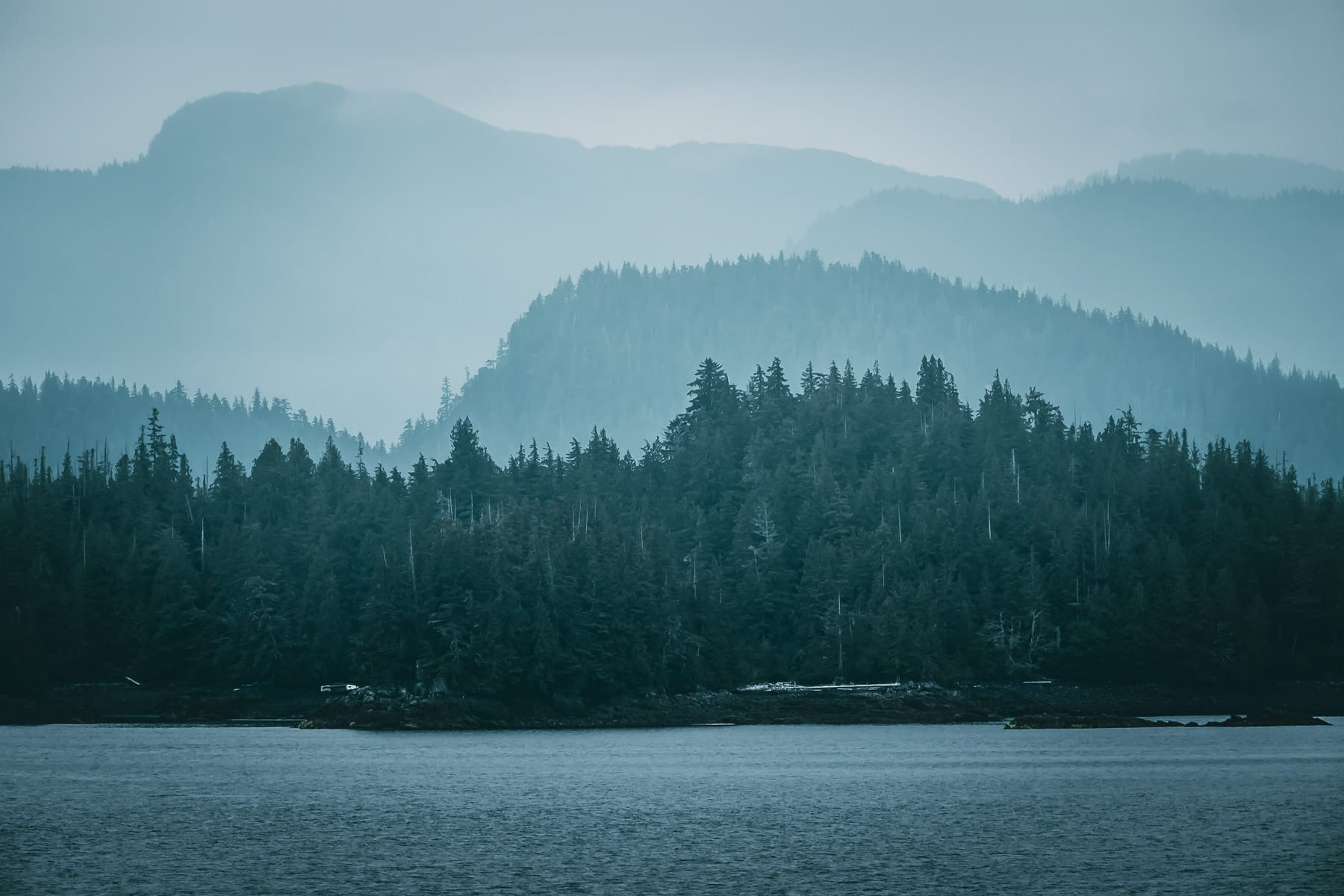 Morning haze over the forested islands along the Tongass Narrows near Ketchikan, Alaska.