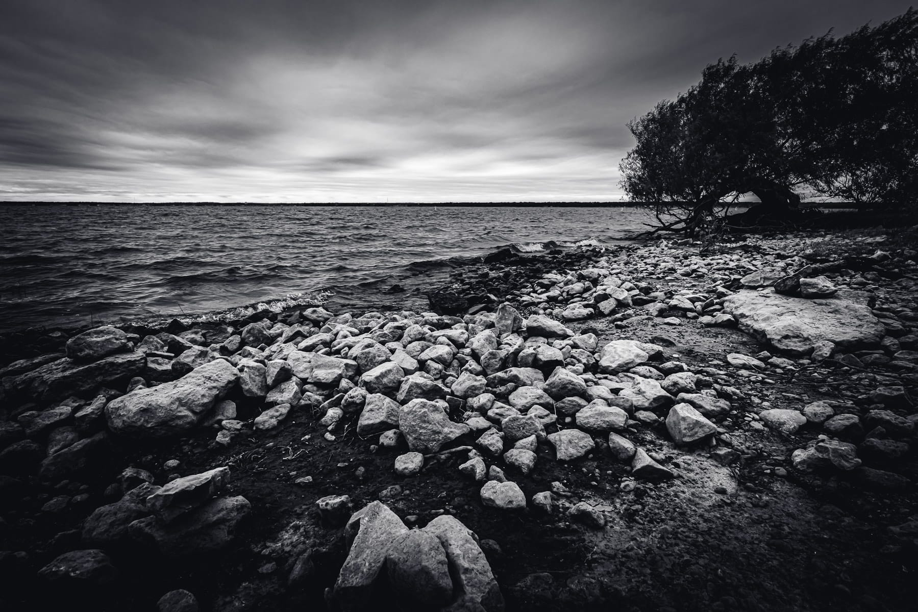 The rocky shore of Texas' Lake Whitney.