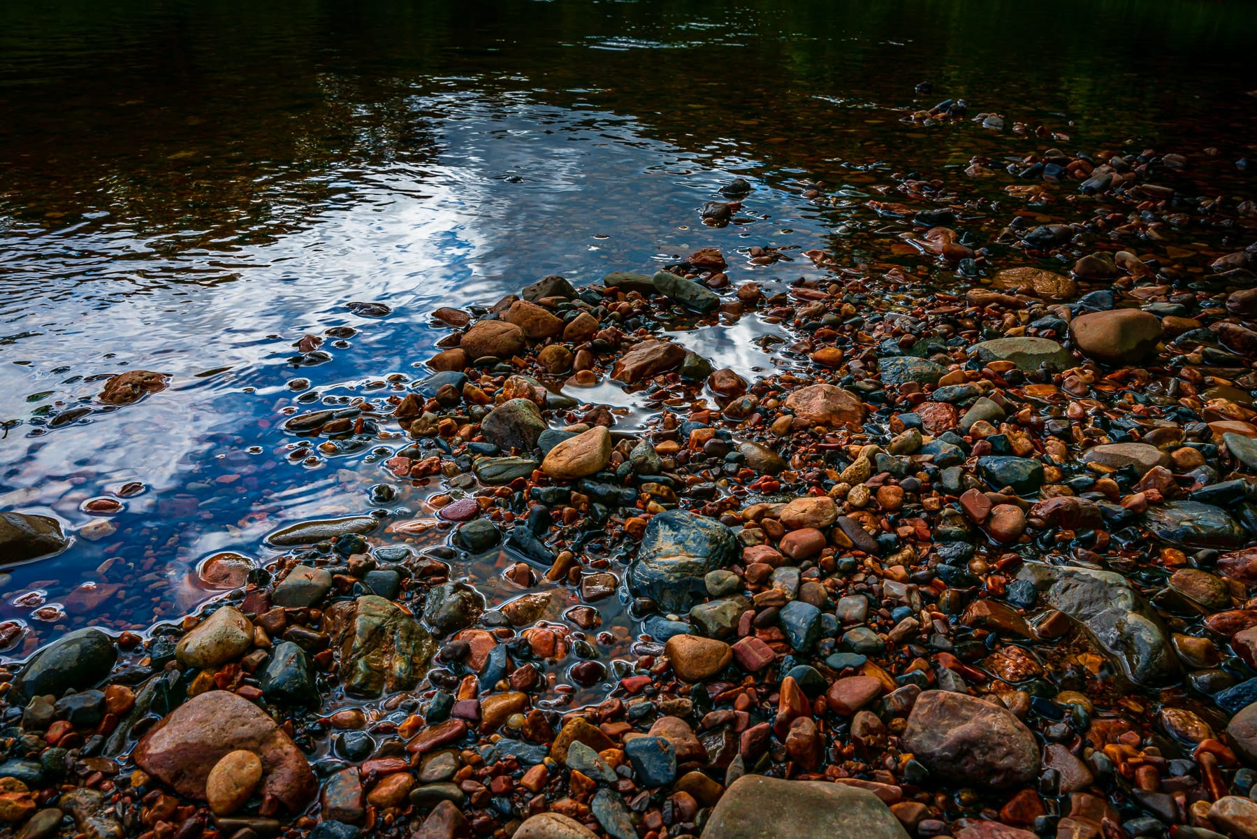 Colorful rocks along the bank of Arkansas' Cossatot River.