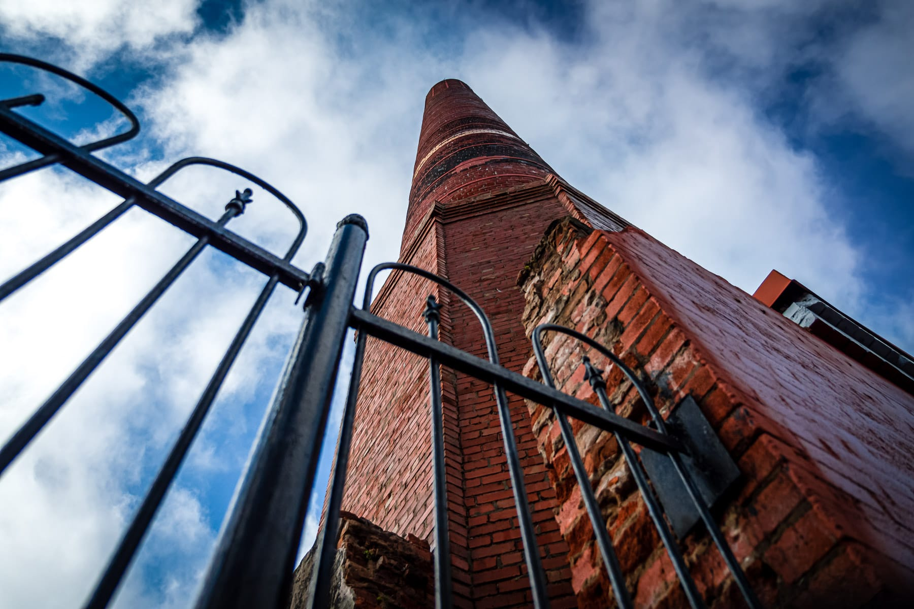 A brick chimney—a relic of a the first ice manufacturing plant in Texas—rises towards the clouds over Downtown Galveston, Texas.