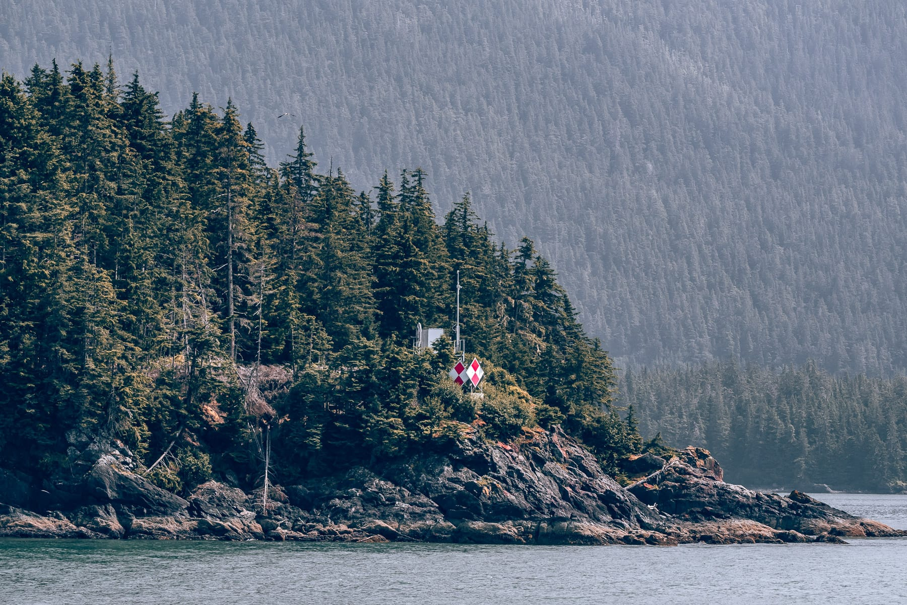 A maritime navigation beacon on a small island in Alaska's Stephens Passage, near Juneau.