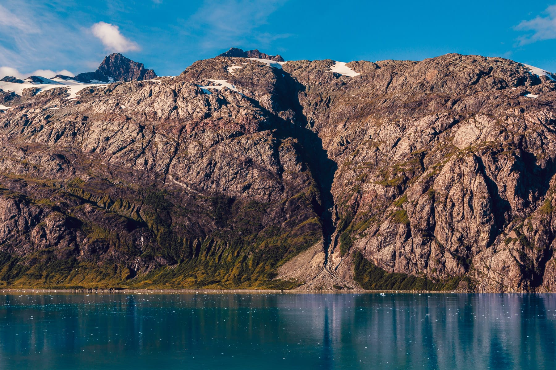 The mountainous landscape of Alaska's Glacier Bay National Park.
