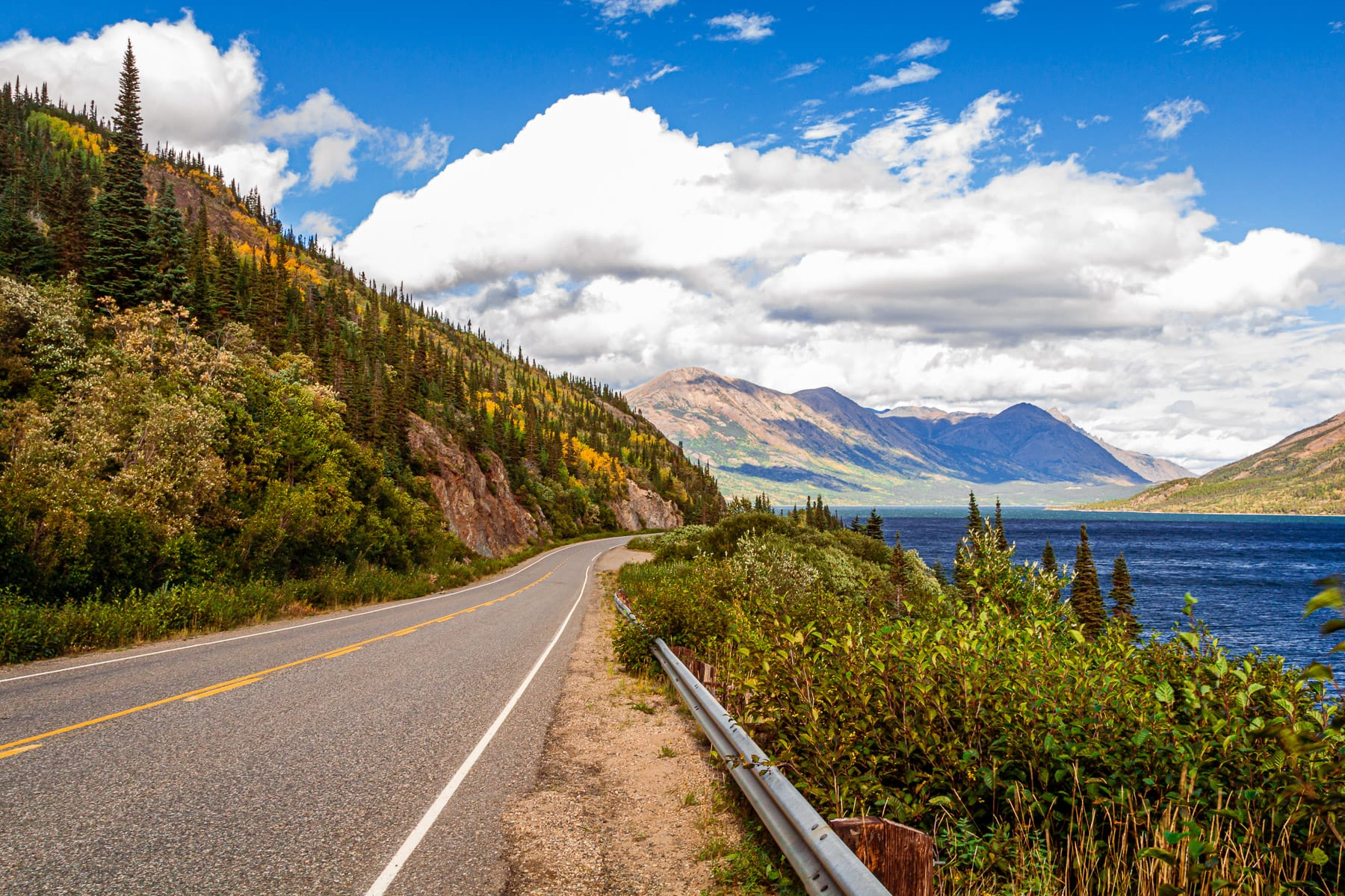 The Klondike Highway stretches along the shore of Tutshi Lake in the Stikine Region of British Columbia, Canada.