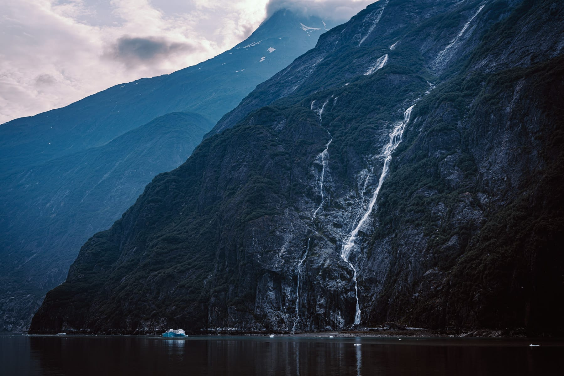 Water cascades down the side of a mountain in Alaska's Tracy Arm Fjord.