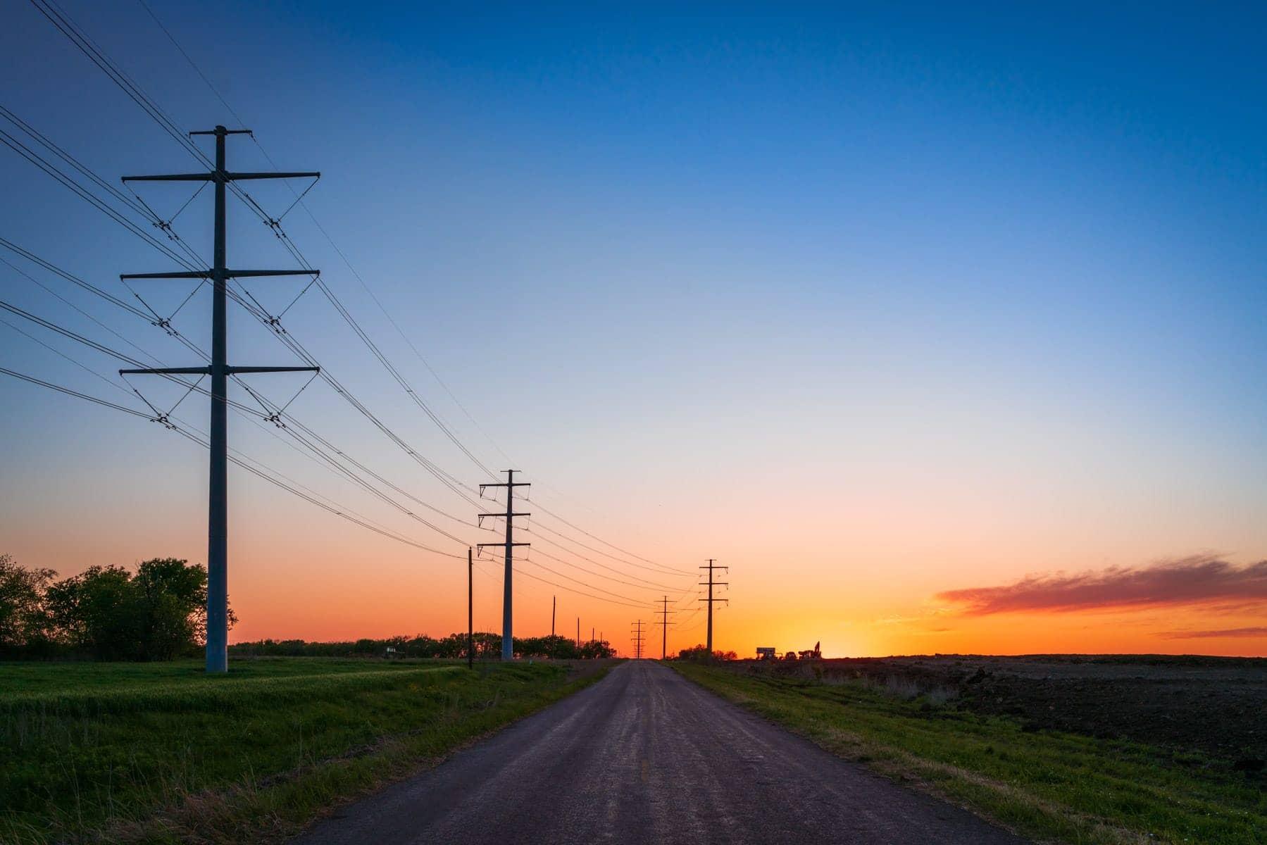 The sun sets on a farm road near Chambersville, Texas.