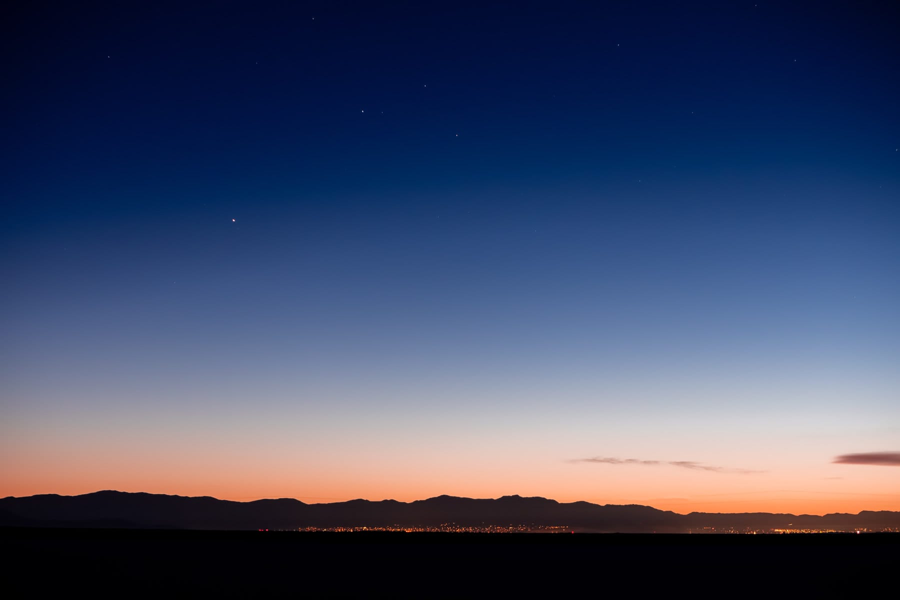 The distant lights of Salt Lake City in the early morning, as seen from Stansbury Island.