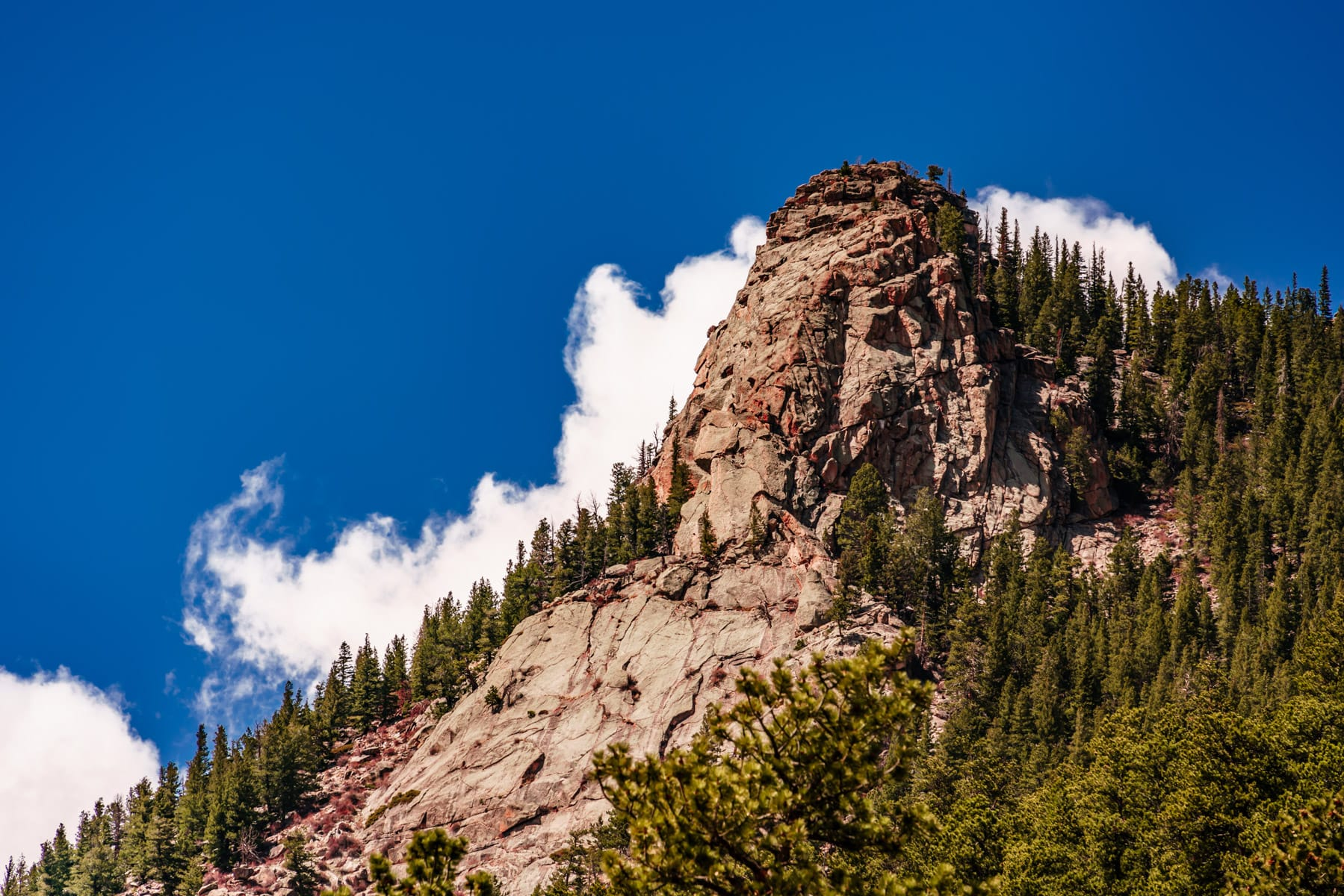 A rocky outcropping reaches into the sky at Colorado's Rocky Mountain National Park.