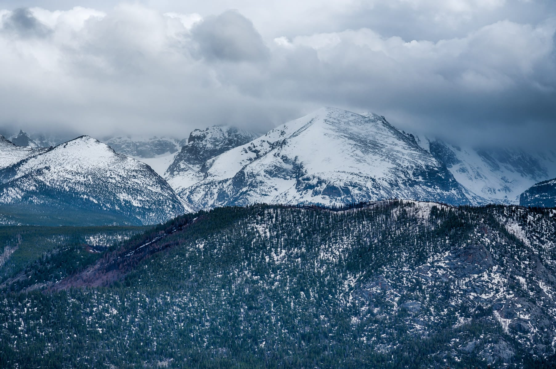A late-winter snowstorm rolls in over Colorado's Rocky Mountain National Park.