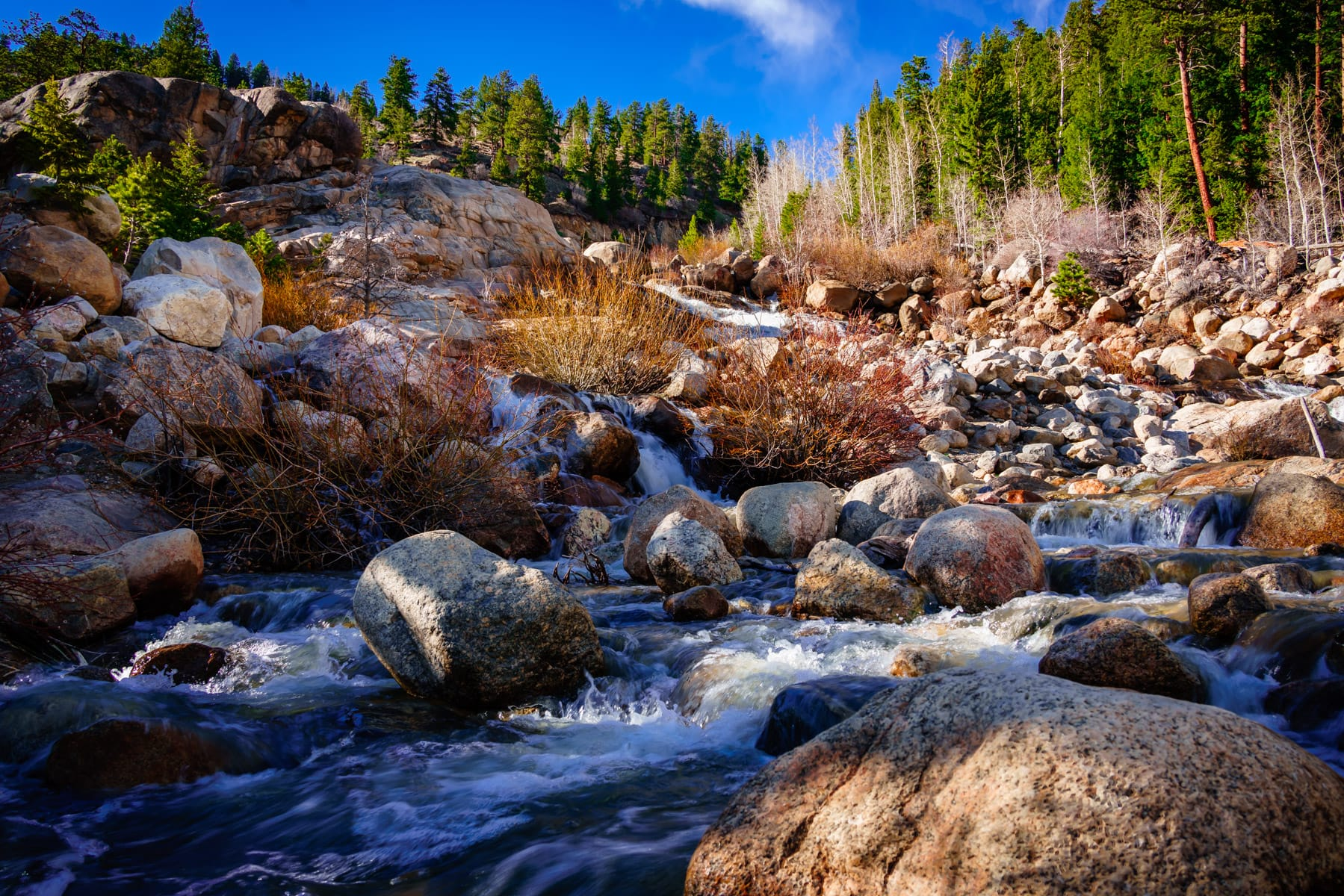 The Roaring River cascades down a rocky path at Colorado's Rocky Mountain National Park.