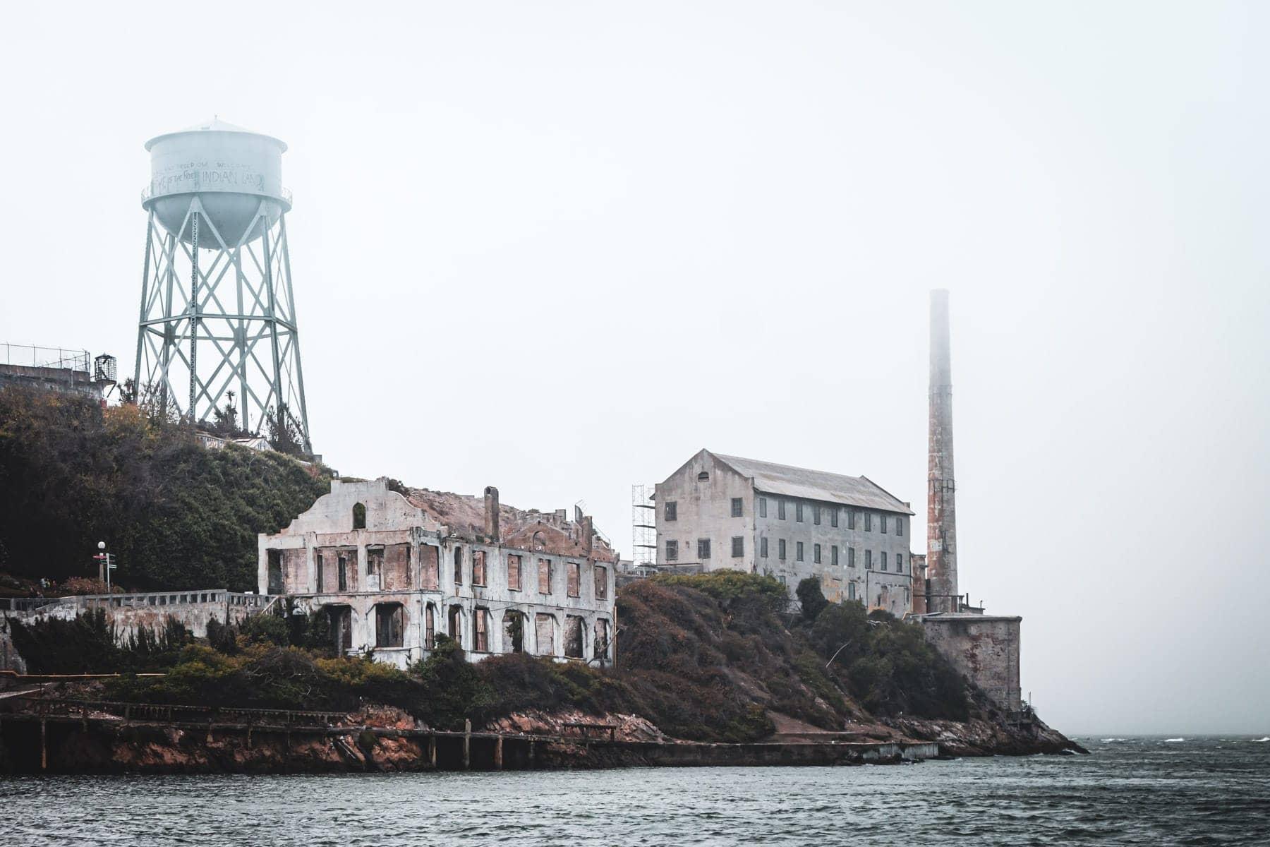 The San Francisco Bay fog envelops the ruins of Alcatraz Prison.