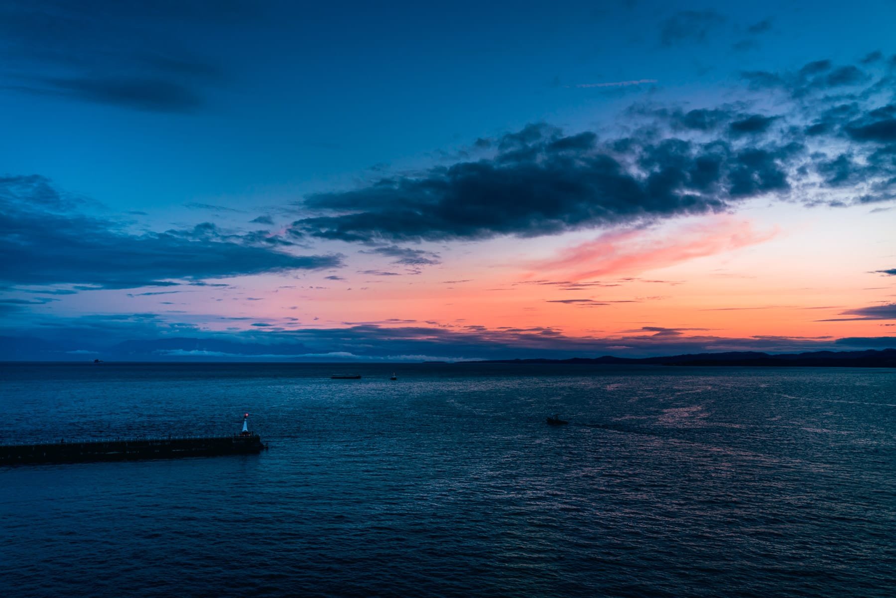 The sun sets on the mouth of Victoria Harbour, Victoria, British Columbia.