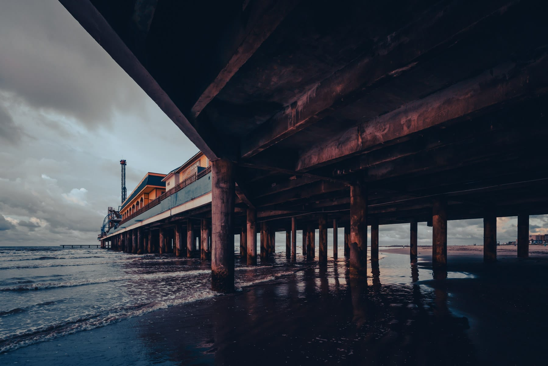 The Galveston Island Historic Pleasure Pier stretches into the waters of the Gulf of Mexico.
