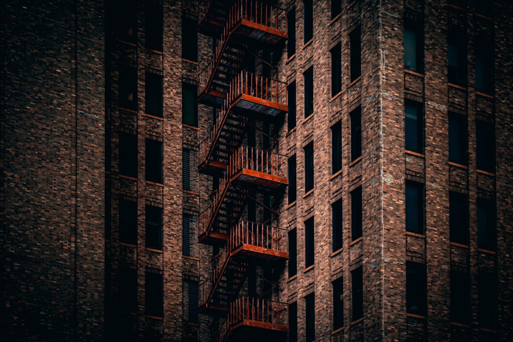 A fire escape climbs the outside of Downtown Houston's Great Southwest Building.