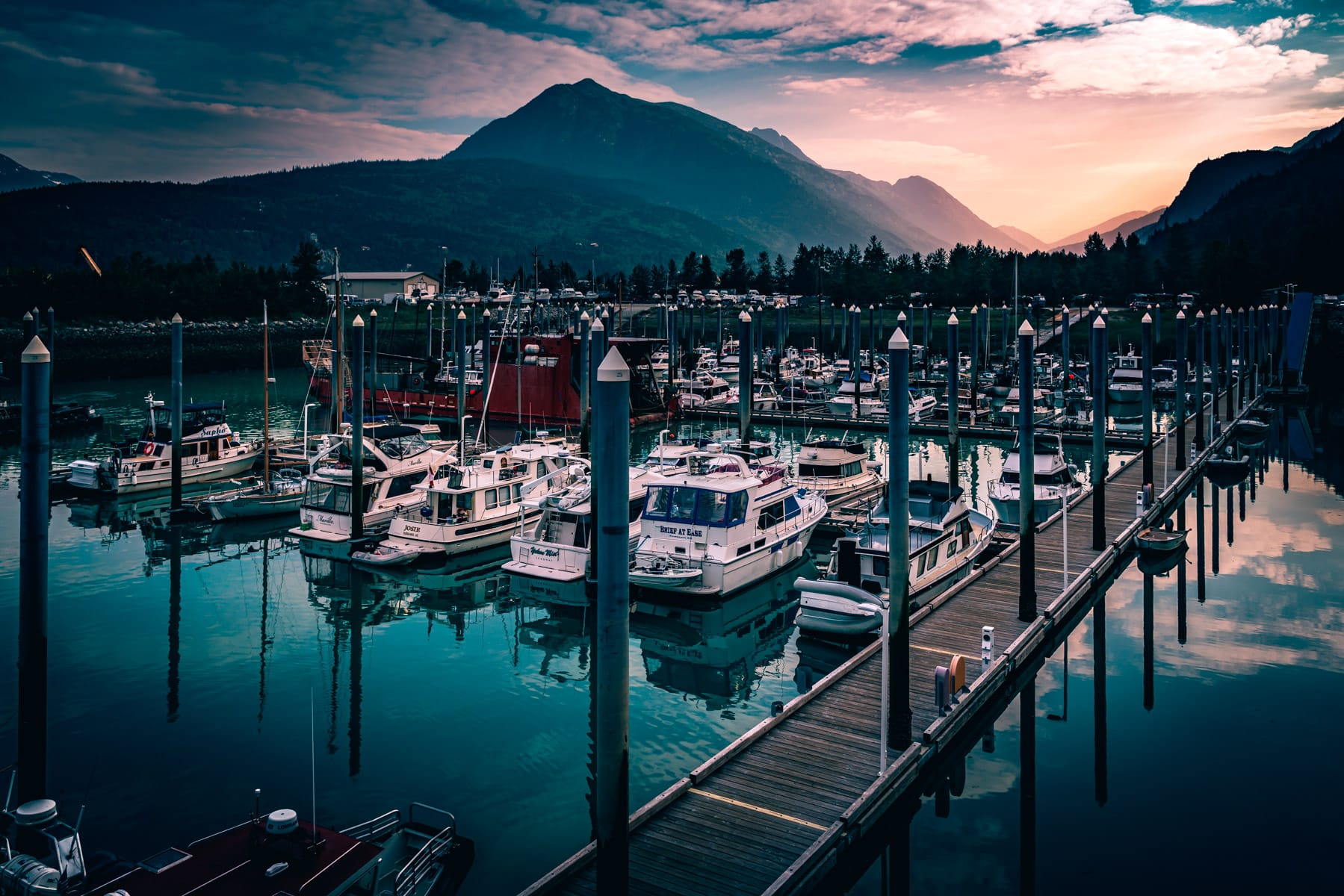 The sun rises on boats in the harbor at Skagway, Alaska.