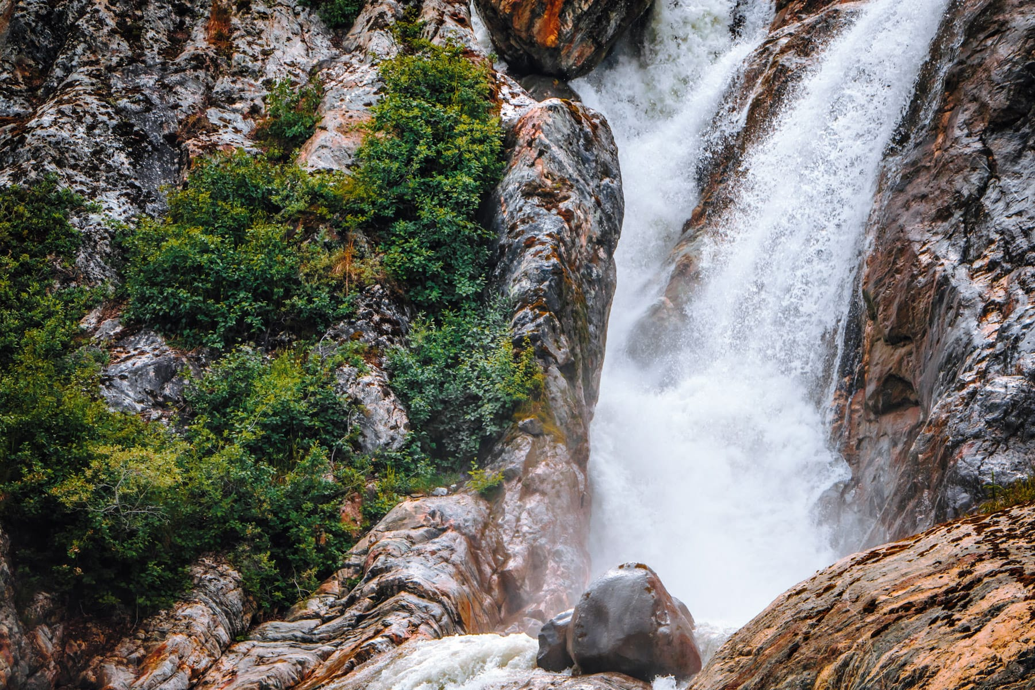 A waterfall along the rocky cliffs along Alaska's Tracy Arm Fjord.