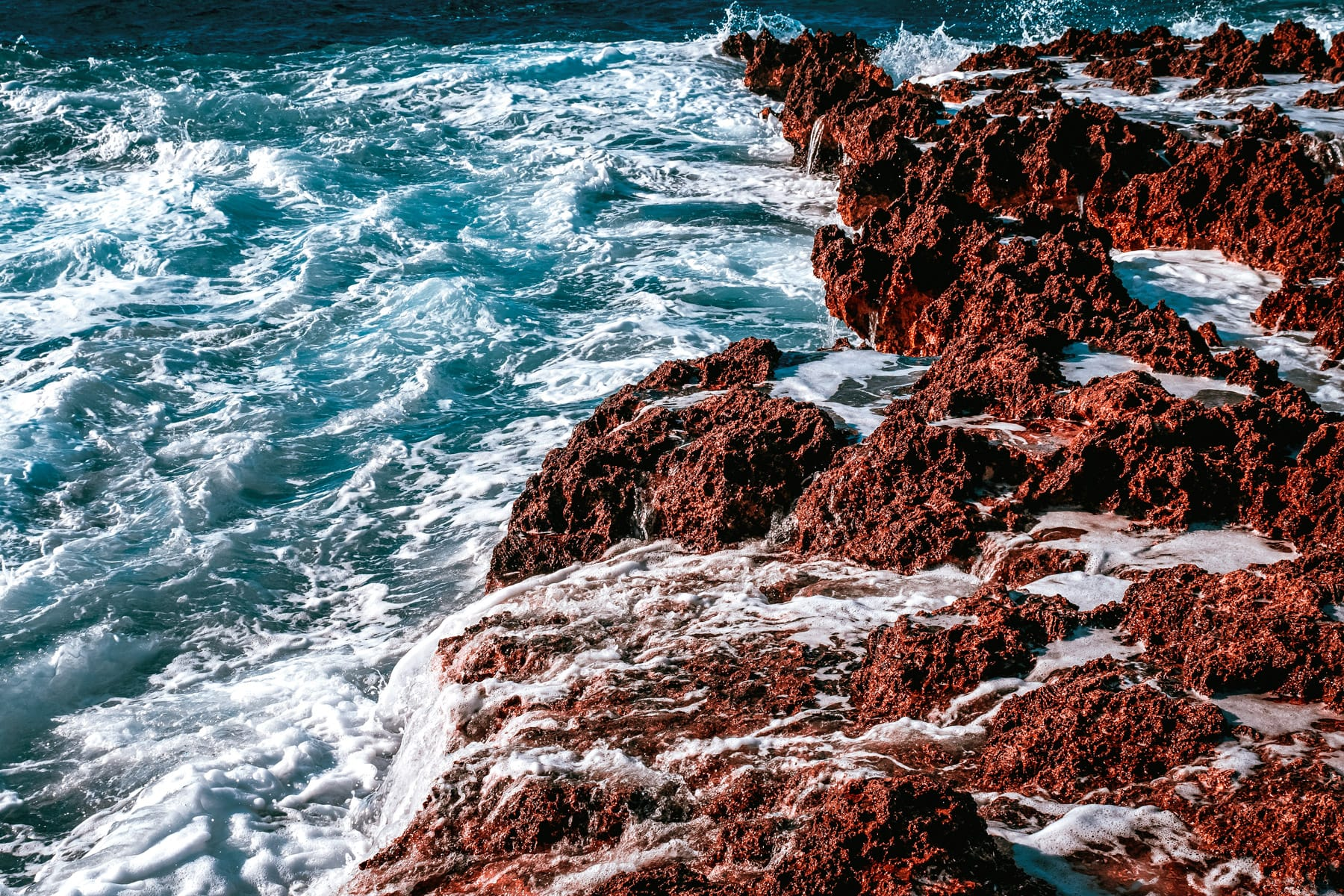 The Caribbean Sea crashes ashore on the jagged rocks of Grand Cayman's Turtle Reef.
