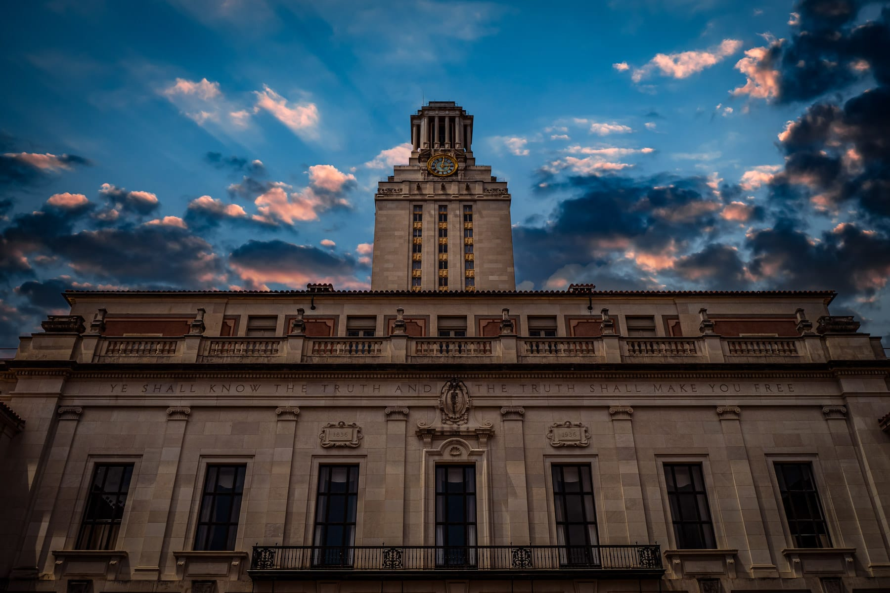 The Main Building (UT Tower) at the University of Texas reaches into the evening sky over Austin.