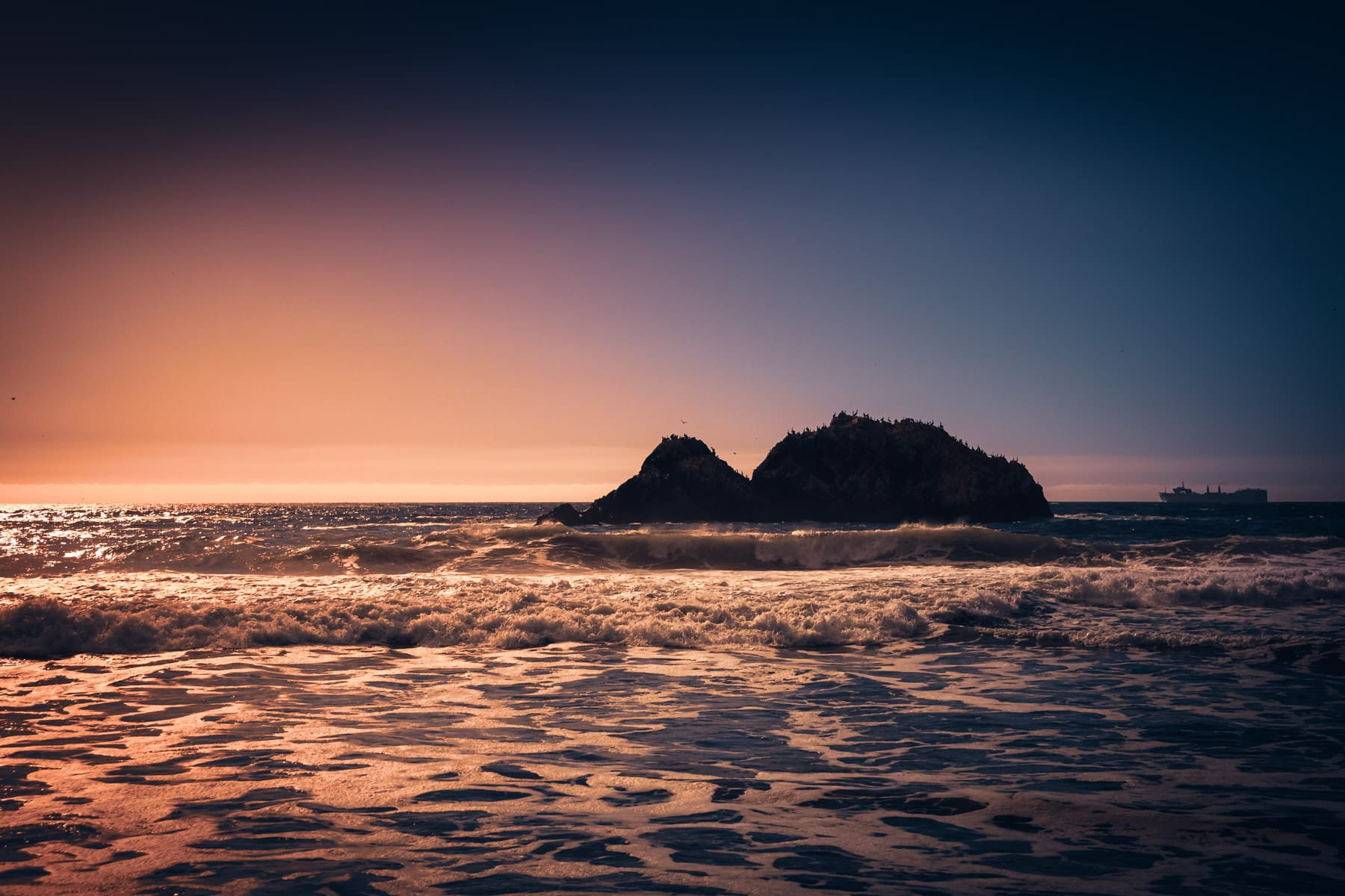 The sun sets on Seal Rocks, off the shore of Lands End, San Francisco.