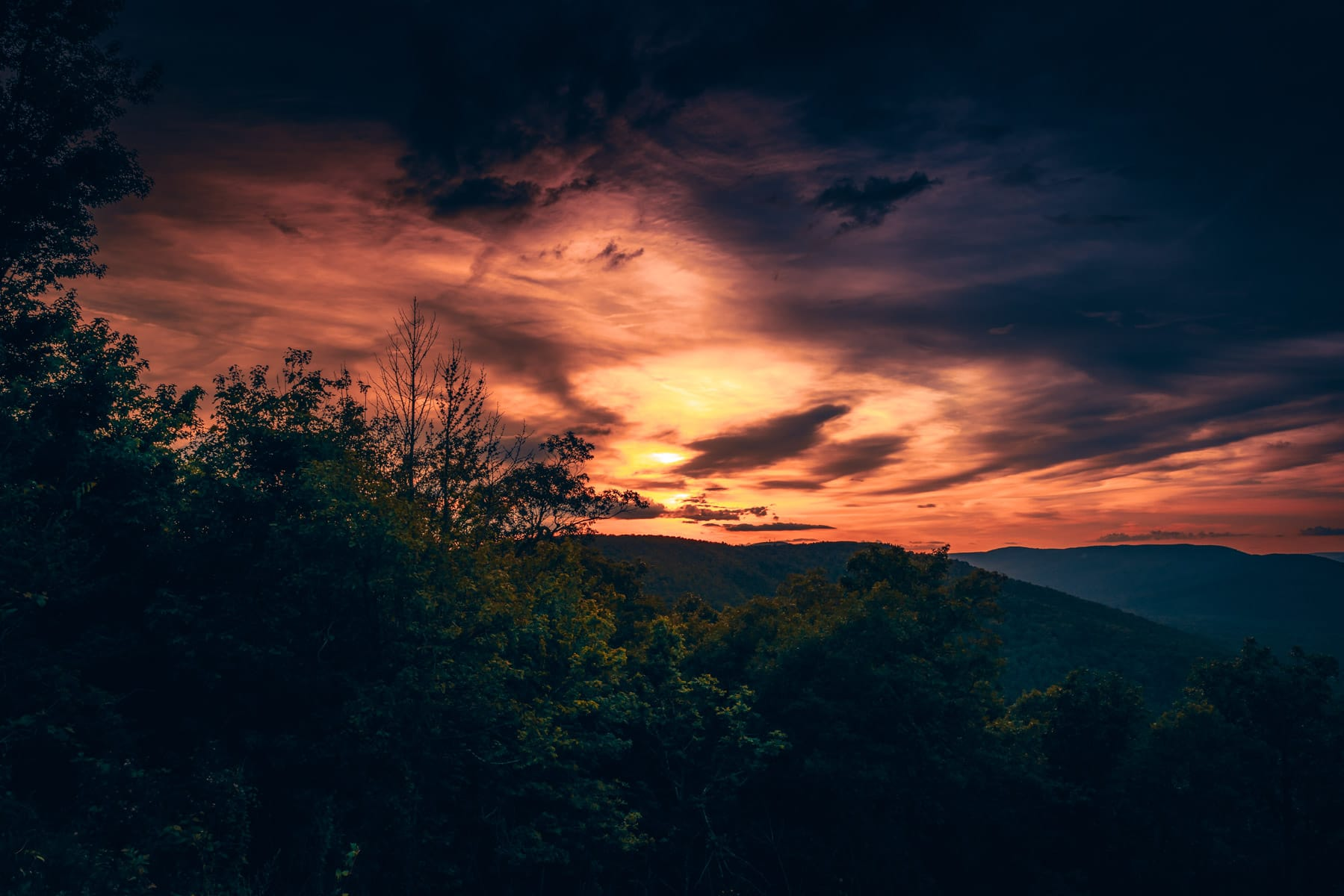 The last light of day sets the sky afire in the Ouachita Mountains near Mena, Arkansas.
