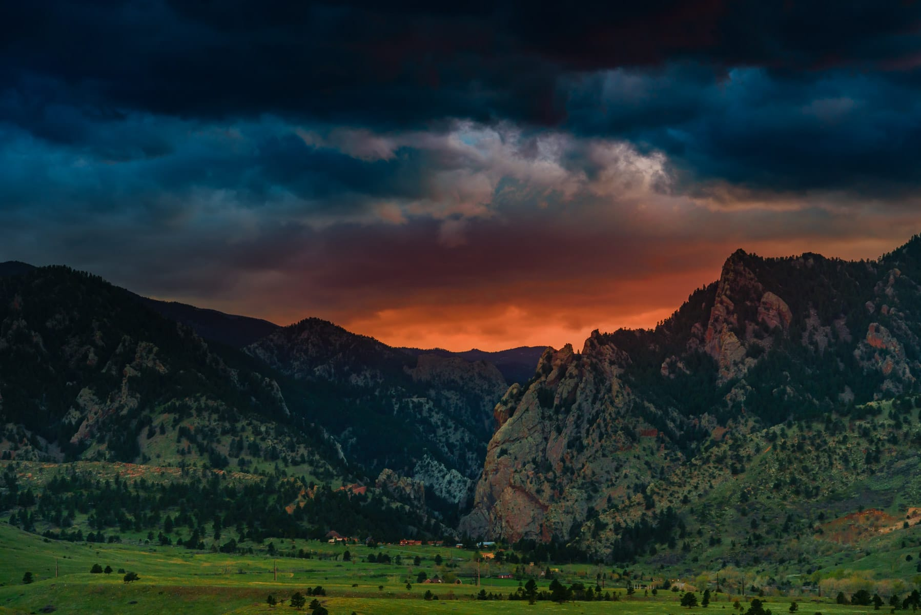 The sun sets on the far side of the Rocky Mountains near Boulder, Colorado.