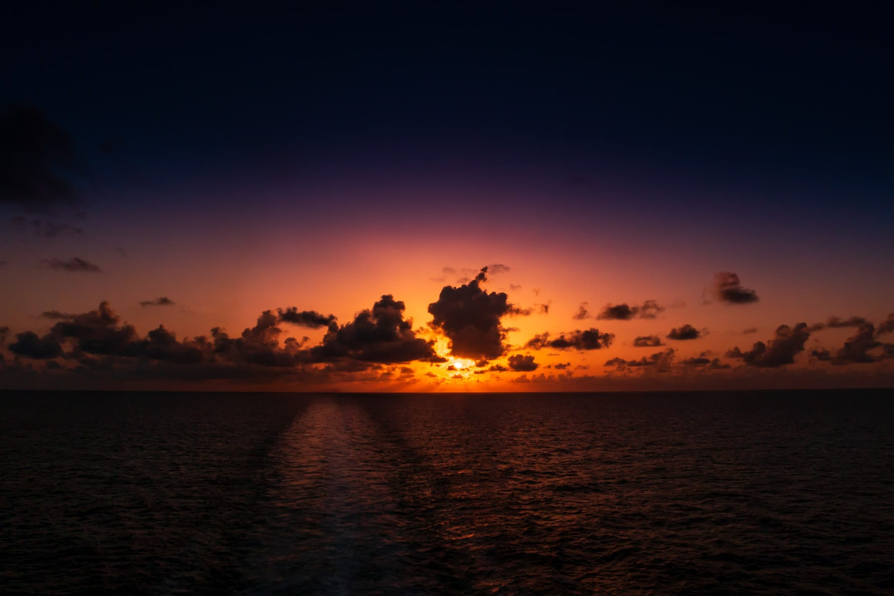 The sun sets on the Gulf of Mexico somewhere offshore of Galveston Island, Texas.