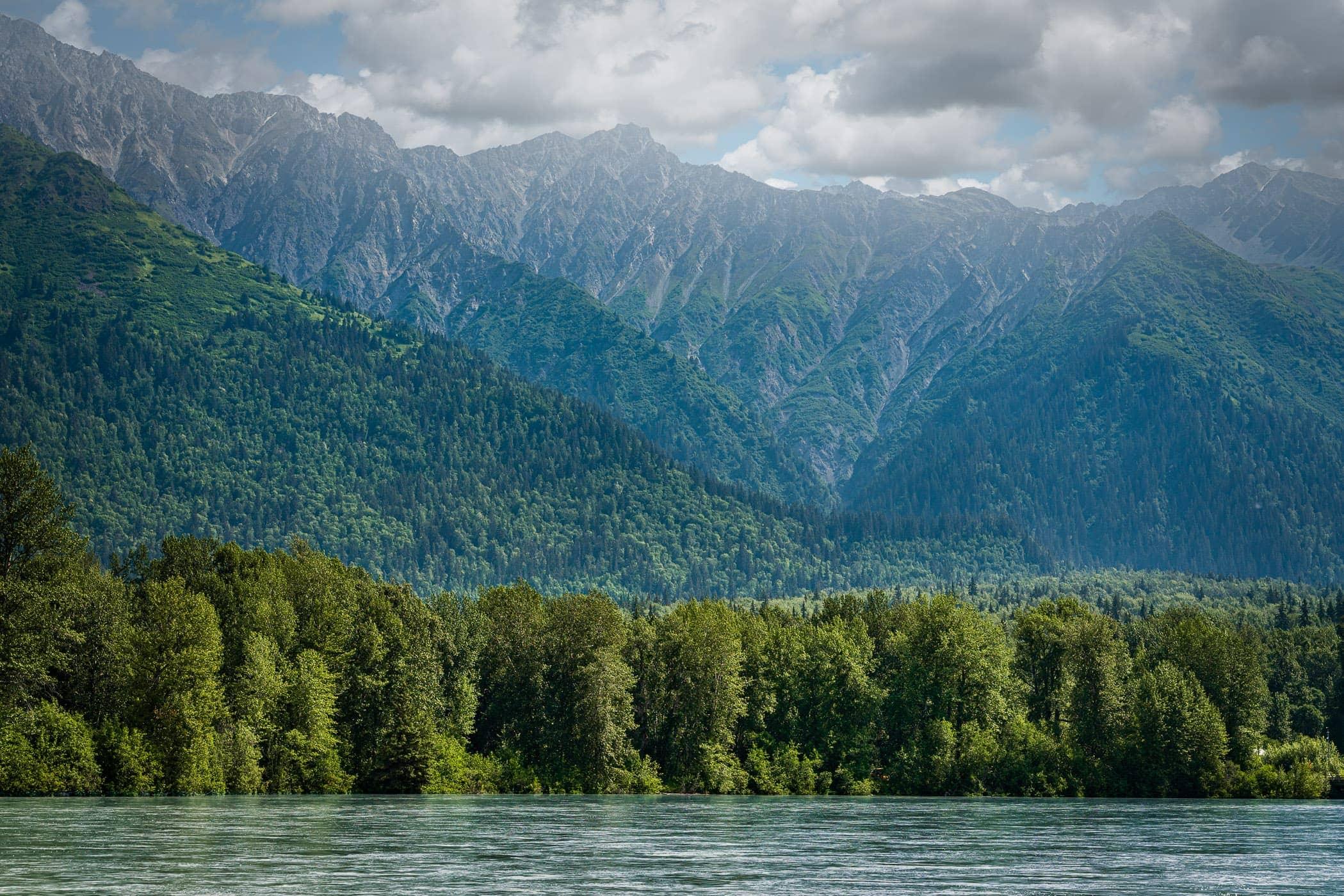 Haze obscures the mountainous landscape along the Chilkat River near Haines, Alaska.