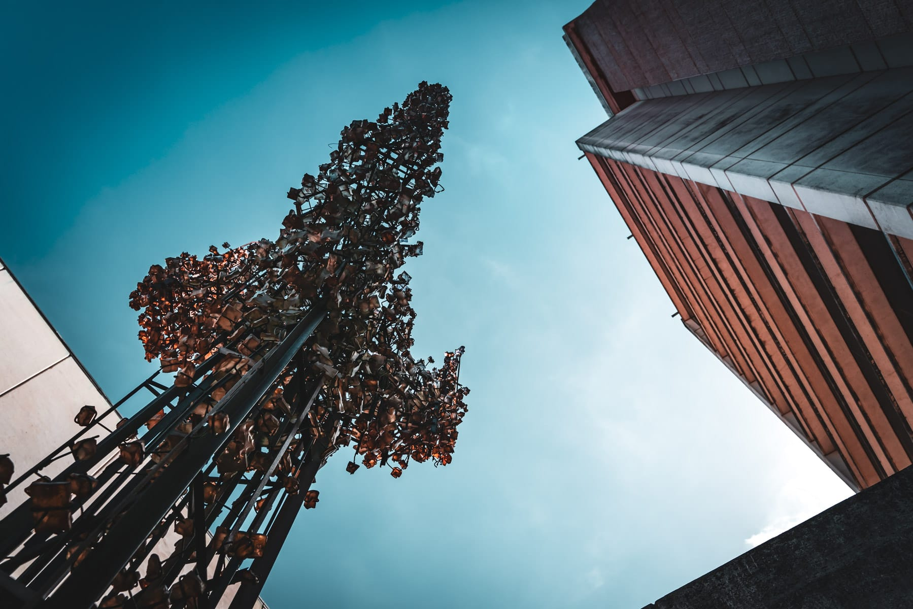 """The 36-foot-tall sculpture """"Tri-Nimbus Crystallis"""" by artists Hillard M. Stone and John Kebrle reaches towards the sky adjacent to Rudder Tower on the campus of Texas A&M University."""