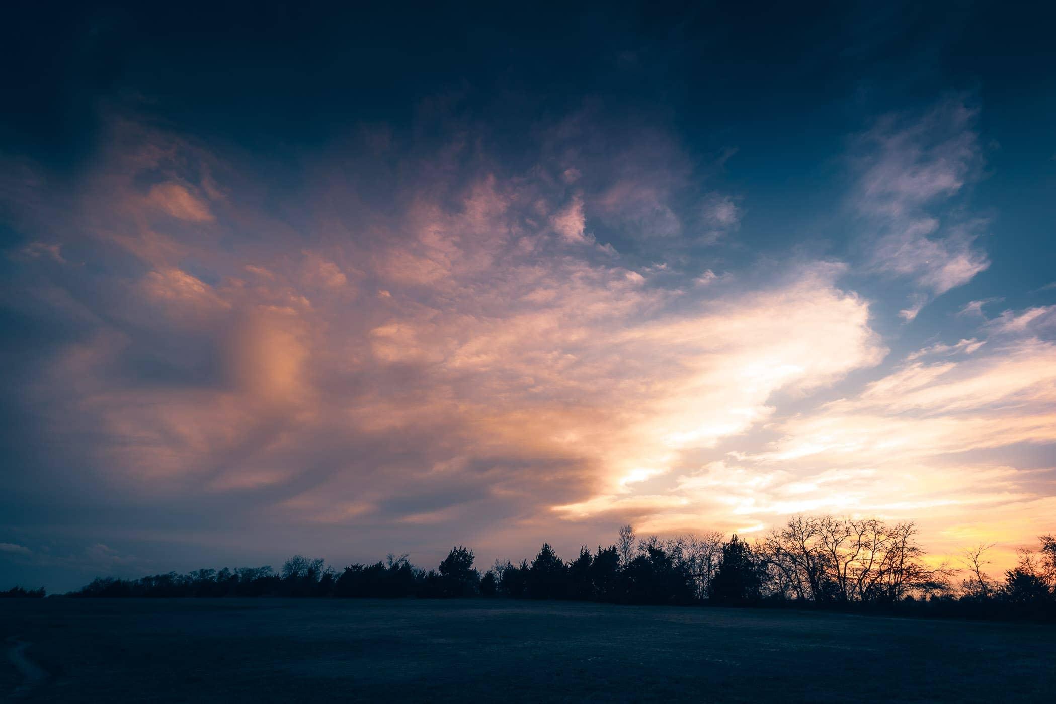 The sun sets over McKinney, Texas' Erwin Park.