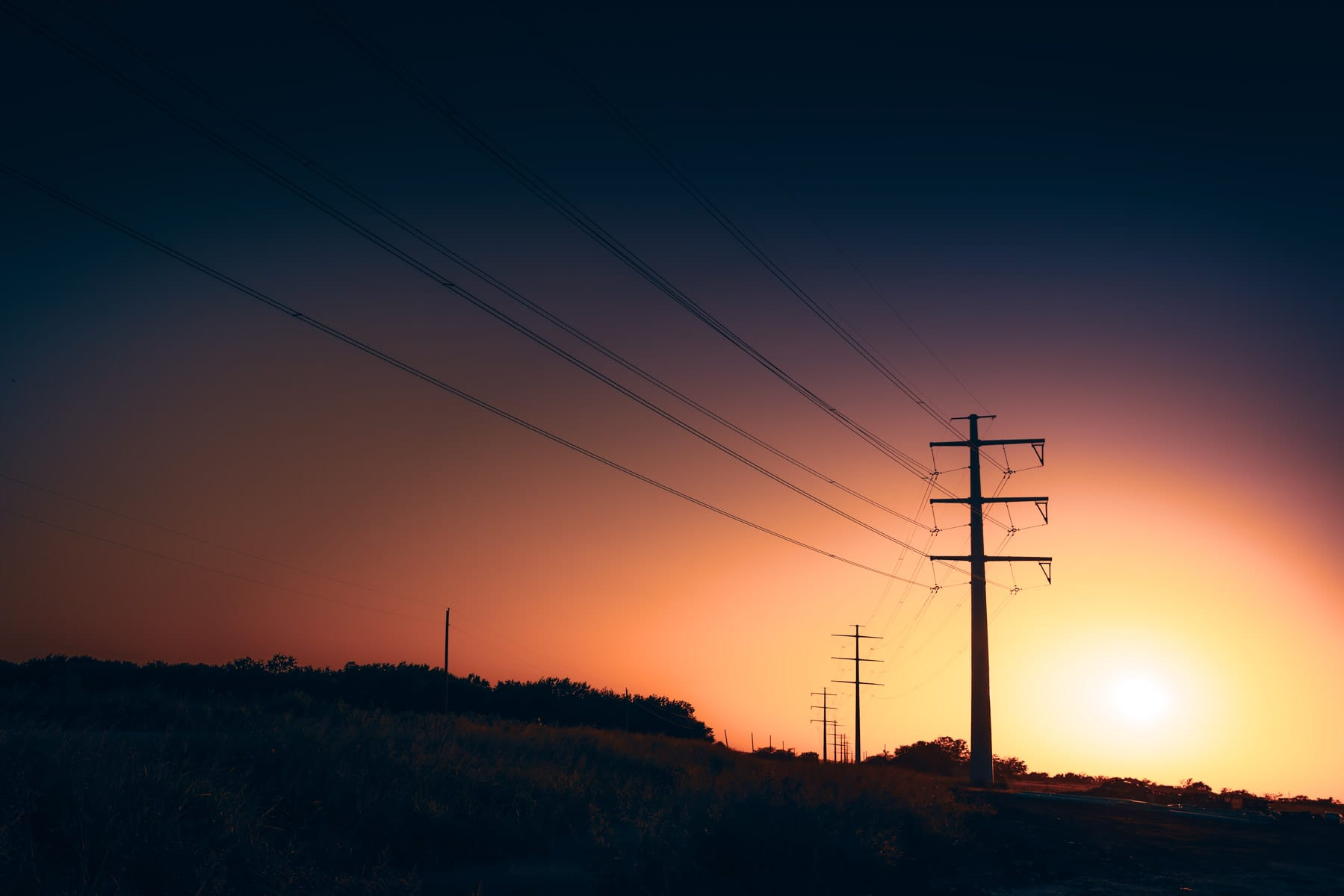 Sunset on power lines near Celina, Texas.